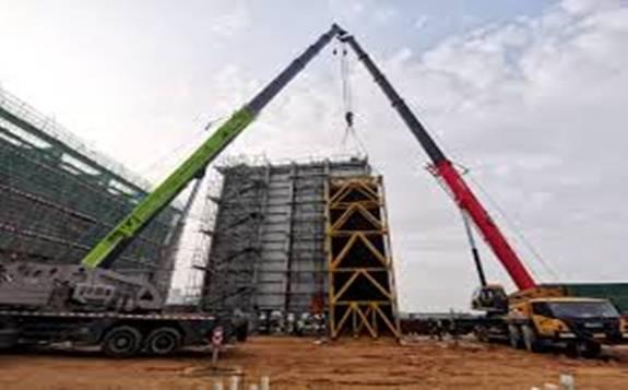 中国能建:江门分布式能源站项目1号燃机发电机穿转完成
